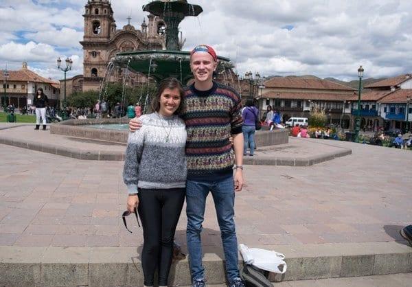 tourists wearing colorful sweaters in Cusco, Peru
