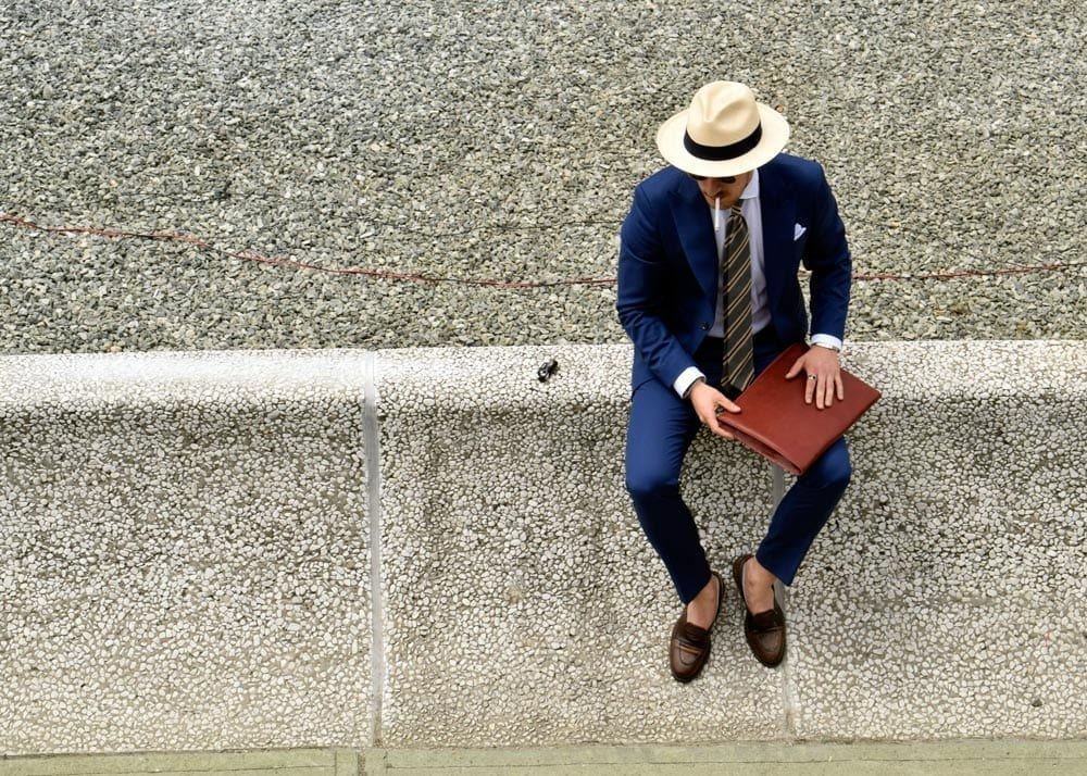 Man in suit, ledge, Pitti 94
