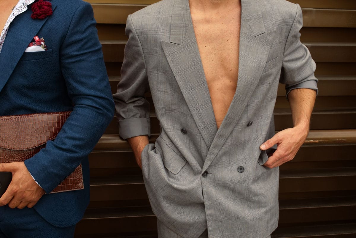 double breasted suit without shirt at pitti uomo