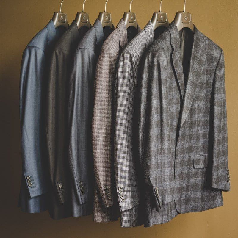 rack of suits from canali
